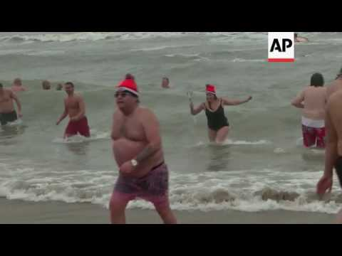 Thousands take New Year plunge in Dutch seaside town