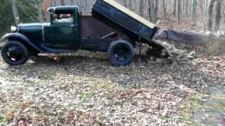 1931 Ford Model AA Dump Truck Dumping Wood -Load 1