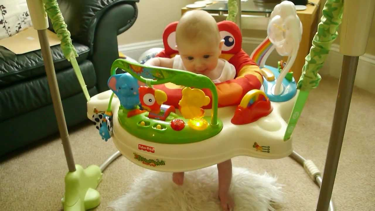 Babies Playing With Toys Tiny Baby Bouncing In Her Rainforest Jumperoo By Fisher