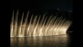 The Dubai Fountain on the backdrop of The Address Downtown Dubai, Souq Al Bahar & Burj Khalifa park