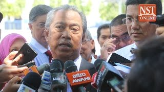Muhyiddin emerges from police questioning, reasserts right to speak on 1MDB