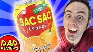 AMERICANS TRY KOREAN FOOD | Taste Test Korean Drink - Assi Orange Sac Sac Review
