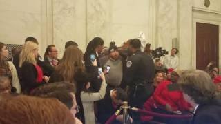 Anti-Sessions protesters were forcibly removed from the hearing