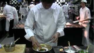 Danzaki prepares a dish at Joël Robuchon, Singapore