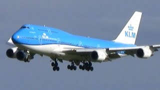 Heavy planes landing in beautiful evening light at Amsterdam airport Schiphol