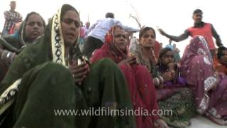 Group of women devotees singing hymns during Chhath Puja