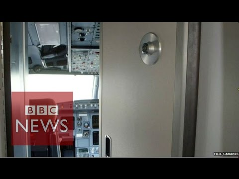 How pilots operate the cockpit door on a commercial jet - BBC News