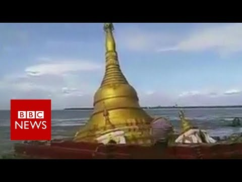 Dramatic footage shows pagoda collapsing into river - BBC News
