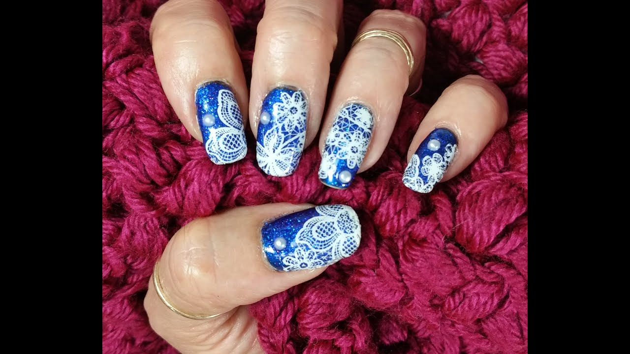 Stamped White Lace Over Holographic Blue Glitter Nail Art Design