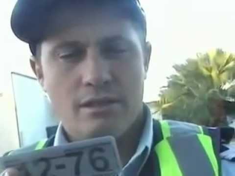 Australian cop stoned