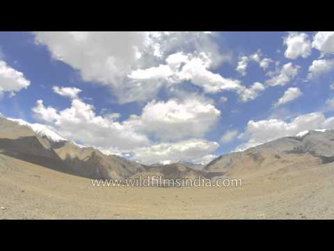 Clouds swirling over the barren mountains of Ladakh