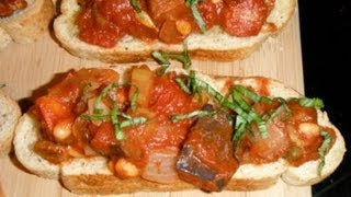 Eggplant Caponata Served On Crostini - Eggplant, Veggies, And Fresh Herbs On Toasted French Bread
