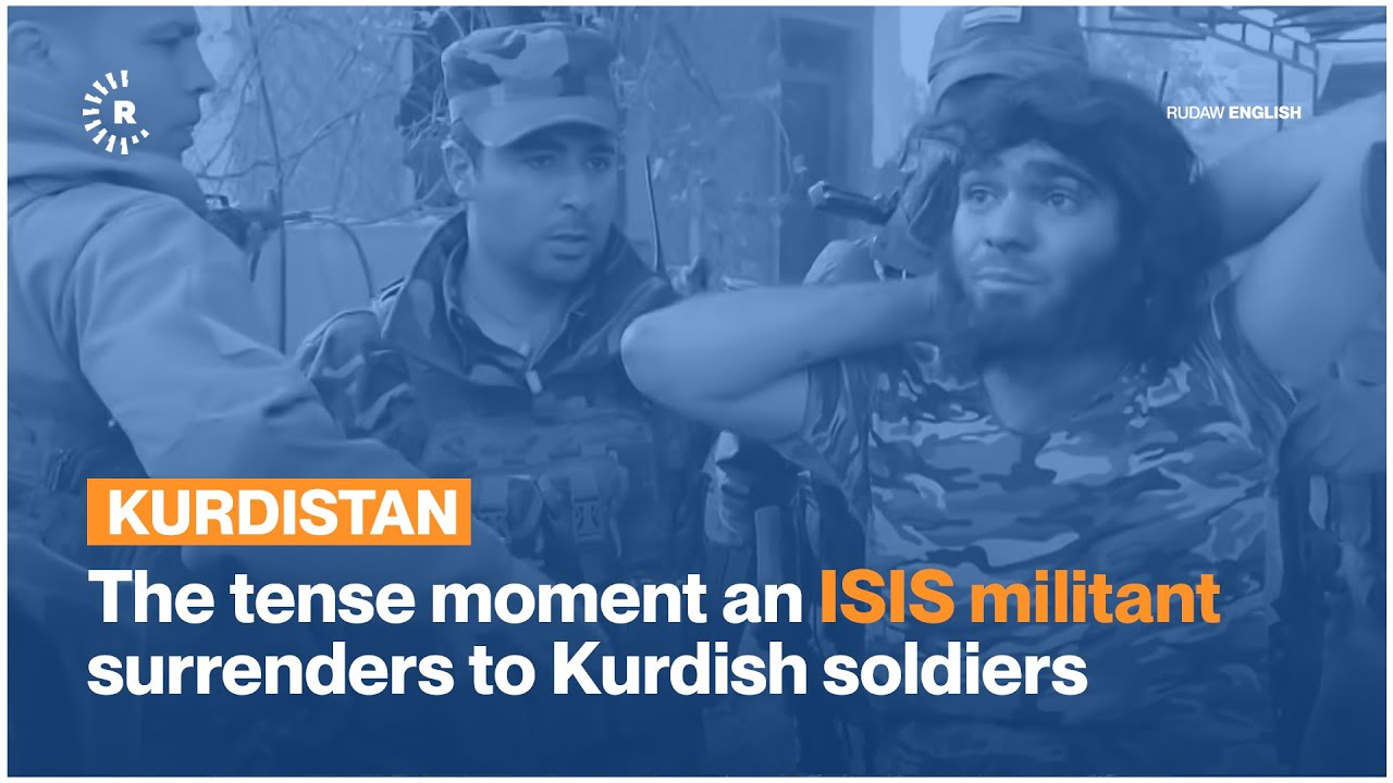 Download The tense moment an ISIS militant surrenders to Kurdish soldiers