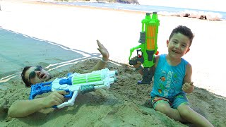 Yusuf and Dad's Water Gun Games
