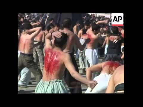 WRAP Afghanis observing Shiite holiday of Ashura, Karbala ADDS Islamabad, Tehran