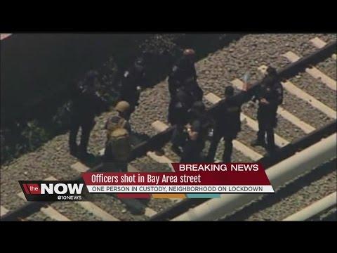 Officers shot in Bay area street