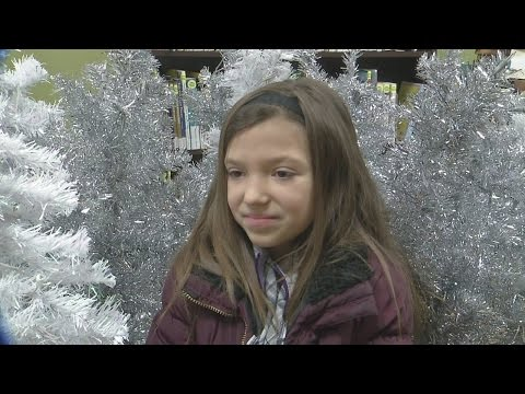 Angola girl gives up Christmas wish list, donates trees to Children's Hospital