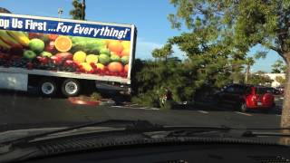 Woman Driver Fail! 99 Cent Only 18 Wheeler Big Rig crashes into tree and pickup truck doing u turn.