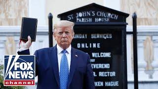 Trump walks to St. John's parish amid rioting near by