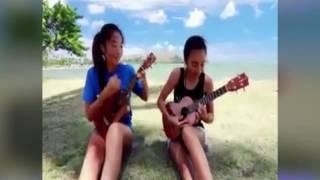 awek cun main gitar tepi pantai