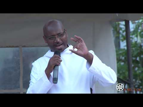 FATHER  JOSEPH OGALO MONG'ELI-AFRICAN BIBLE ON THE GROUND NANYUKI MONASTERY.