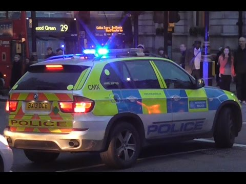 Metropolitan Police Armed Response Vehicle stops a motorbike