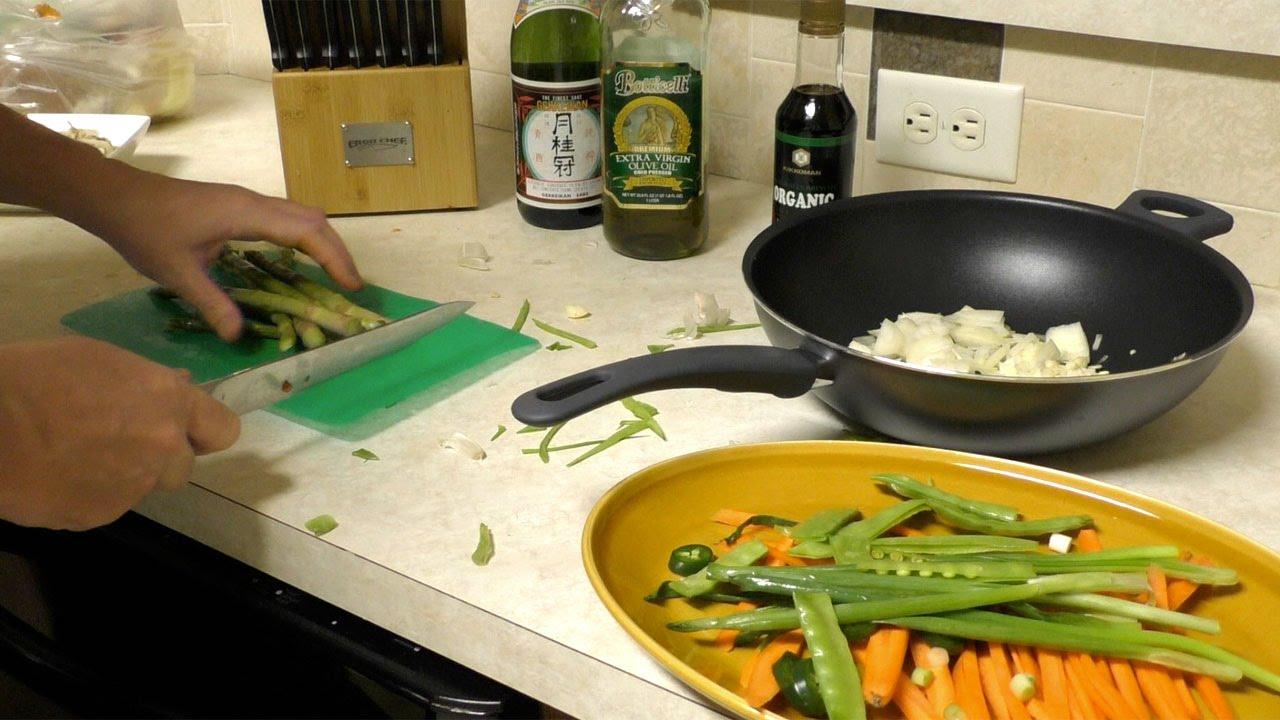 cucinare verdure col wok sake germogli di soia e