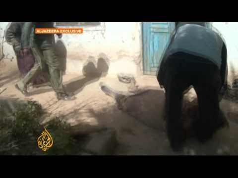 Homs town endures months of shelling