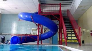 3yo William going down the YMCA pool slide thumbnail