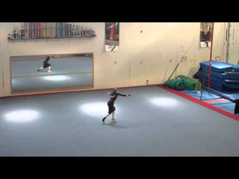 Apostolic Pentecostal gymnast in a skirt doing floor routine.