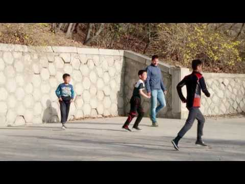 Tourists playing football with local kids in North Korea