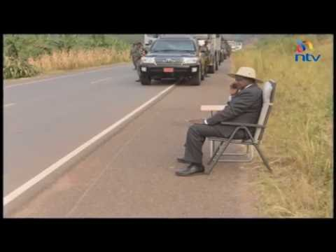 President Museveni answers a phone call by the roadside