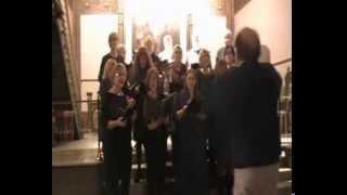 Liga af sang og munterhed synger ett vers av Jeg synger Julekvad