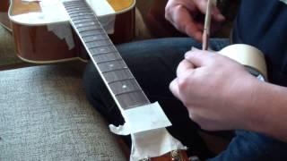 Как можно выровнять лады на гитаре
