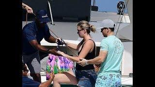 Mark Wahlberg helps Rhea Durham during Barbados break