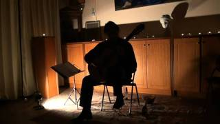 Michalis Sourvinos performing at the classical guitar concert held at the Athens Centre