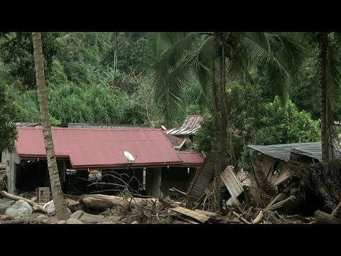 Families fill Philippine shelters after deadly storm Tembin