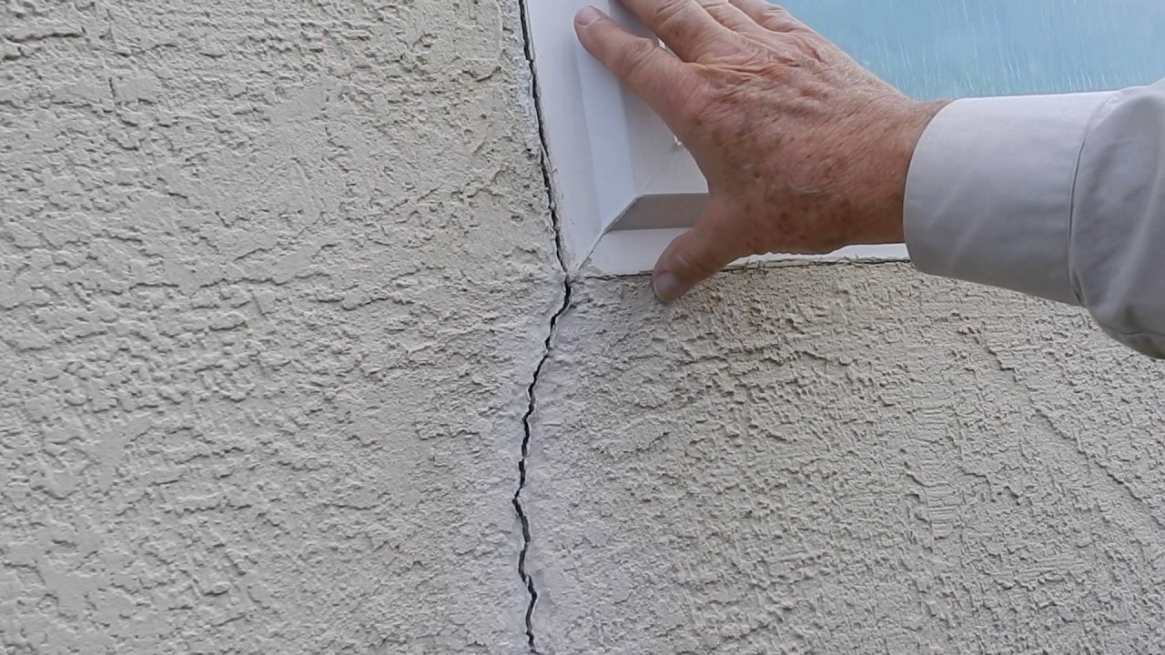 How to patch stucco cracks - Stucco Wall Small Crack At Window Explanation