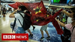 Hong Kong protests: China flag trampled in mall unrest - BBC News