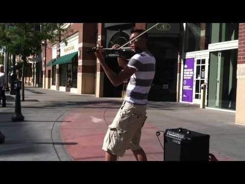 Busking electro-violinist visits Spokane