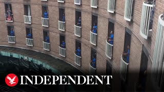 Fijian rugby team sings from balconies to thank hotel staff