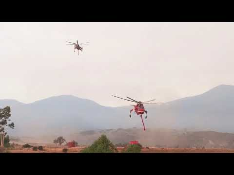 Thomas Fire Helicopters S54's loading fire retardant