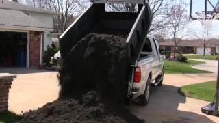 DumperDogg dumping topsoil load