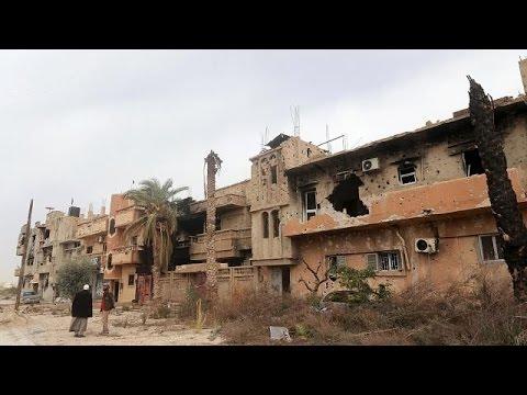 Libyans return to war-battered Benghazi
