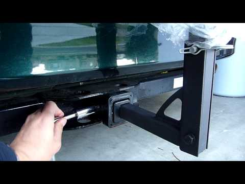 "How to snugly fit a 1 1/4"" or 2""  hitch-mount bike rack  into a 2"" hitch receiver.."