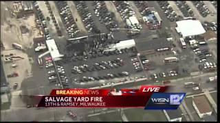 Hot spots reported in Milwaukee auto salvage fire