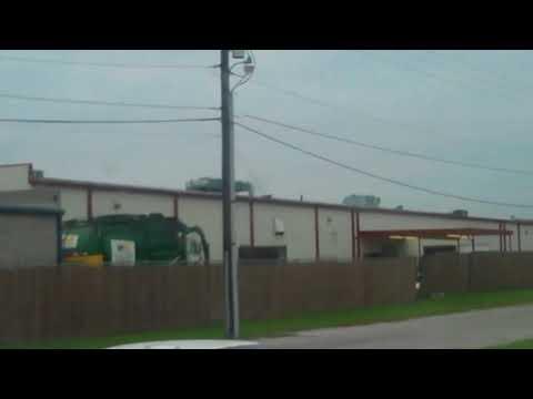 Waste Management Somekey Mack McNeilus Front Loader in action dumping a 6yd WM Dumpster