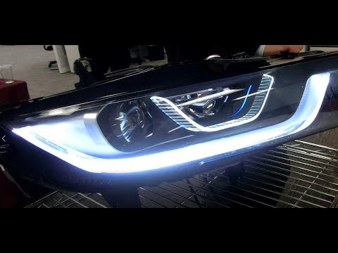 BMW new Headlights with Blue Laser diode converted to white light