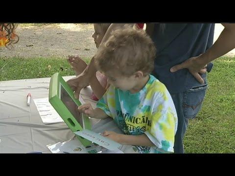 Children celebrate new communication devices