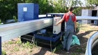 Оборудование для строительства ангаров Радуга-МБС(Видео работы оборудования Радуга-МБС для строительства бескаркасных ангаров и арочных сооружений., 2010-09-21T14:12:24.000Z)